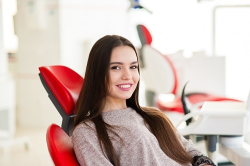 young girl in dental chair