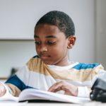 boy doing schoolwork
